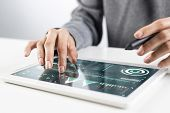 Man In White Business Suit Using Tablet Computer. Close-up Of Male Hands Holding Pen And Tablet Gadg poster