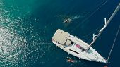 Sailing Regatta, Boat Trip, Top View. White Yacht In The Blue Sea, Drone Photo. People Relax On A Ya poster
