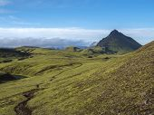 Volcanic Landscape With Footpath Of Laugavegur Trek And Green Storasula Mountain With Lush Moss And  poster