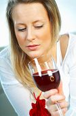 picture of matron  - pretty young blond women with glass of red wine - JPG
