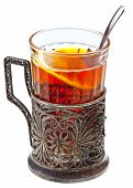 stock photo of melchior  - black tea with lemon in retro glass with teaspoon and glass - JPG