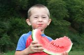 Jolly Boy Eating Greedily Tasty Watermelon.
