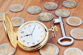 Gold Pocket Watch On The Background Euro Coins And Keys.