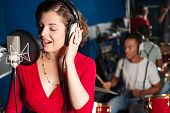 foto of singer  - Female playback singer recording a track at studio - JPG