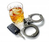stock photo of handcuff  - Whiskey with car keys and handcuffs concept for drinking and driving - JPG