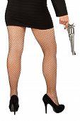 image of fishnet stockings  - Legs of dangerous woman with handgun and black shoes fishnet stockings - JPG