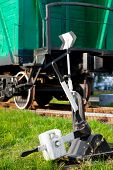 picture of covered wagon  - old railway switch and retro train wagon - JPG
