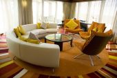stock photo of scant  - Modern living room with round sofa colorful pillows and stylish design  - JPG