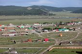 picture of ulaanbaatar  - The sweeping remote hills of Mongolia are marked only by primitive roads and clusters of simple cabins. ** Note: Soft Focus at 100%, best at smaller sizes - JPG
