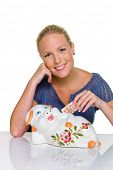 pic of passbook  - a young woman smiles and gives fifty euros in a piggy bank - JPG