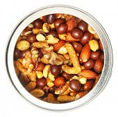 Open Tin Can of Mixed Nuts Over White Top View