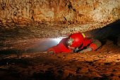 picture of cave woman  - Narrow cave passage with a spelunker explorer