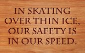 In skating over thin ice, our safety is in our speed - quote by Ralph Waldo Emerson on wooden red oa