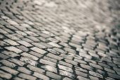 stock photo of paving  - Paving Stone surface with shallow depth of field in retro style