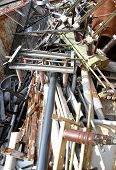 pic of scrap-iron  - piles of scrap iron with broken and rusted objects in a special waste landfill - JPG