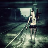 pic of doomsday  - Sexy blond woman killer holding automatic and gun - JPG