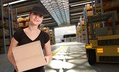 Smiling female worker in a distribution warehouse