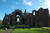 image of embalming  - Melrose Abbey in the Scottish Borders is a beautiful and atmospheric red sandstone medieval ruin - JPG