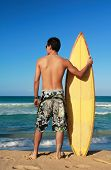 Surfer Holding A Surf Board