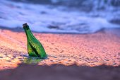 bottle with letter in sea water