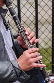 image of clarinet  - A man plays a clarinet in the street - JPG