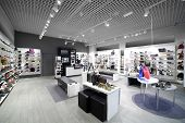 stock photo of department store  - bright and fashionable interior of shoe store in modern mall - JPG