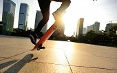 pic of skateboarding  - young woman skateboarder skateboarding at sunrise city - JPG