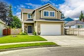pic of driveway  - Two story house exterior with white door garage and driveway  - JPG