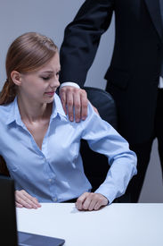 stock photo of inappropriate  - Young boss and his inappropriate behaviour - JPG