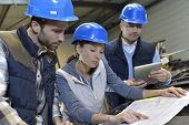 image of engineering construction  - Industrial engineers meeting in mechanical factory - JPG
