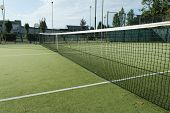 stock photo of hollow point  - green tennis court in the town of la spezia - JPG