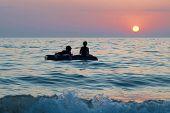 foto of raft  - People on the raft with sea - JPG