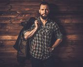 foto of canvas  - Handsome man wearing checkered  shirt and waxed canvas jacket  - JPG