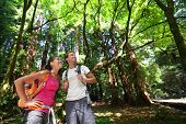 image of woman couple  - Hiking couple in forest Redwoods - JPG