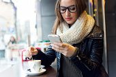 picture of beauty  - Portrait of beautiful girl using her mobile phone in cafe - JPG