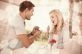 picture of marriage proposal  - Man proposing marriage to his shocked blonde girlfriend on the cafe terrace on sunny day - JPG