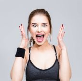 stock photo of unbelievable  - Portrait of a sports woman feel surprised facial expression - JPG