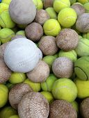 picture of softball  - softball with Tennis ball in iron basket - JPG