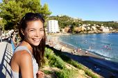 stock photo of elm  - Tourist woman on beach summer vacation in Mallorca  - JPG