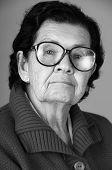 foto of nostalgic  - closeup portrait of grandmother looking nostalgic at camera black and white - JPG