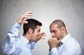 stock photo of angry man  - Angry man shouting to another man - JPG