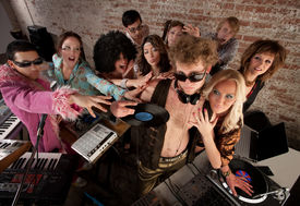 stock photo of lps  - Famous DJ crowded by fans and requests at a party - JPG