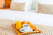 picture of bed breakfast  - tray with healthy breakfast in bed in the hotel room