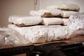 image of drug dealer  - Drug packages raw opium drug dozens and weapons seized by police - JPG