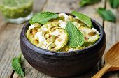 stock photo of millet  - zucchini millet mint pumpkin seeds goat cheese salad with coriander dressing - JPG