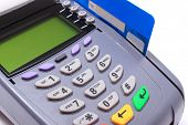 image of terminator  - Payment terminal with credit card on white background credit card reader payment terminal finance concept - JPG