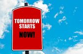 picture of start over  - Tomorrow Starts Now motivational quote written on red road sign isolated over clear blue sky background - JPG