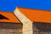 picture of red roof  - The wall and the red tile roof mediterranian architecture - JPG