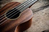 pic of ukulele  - Close up of ukulele on old wooden background Dark tone - JPG