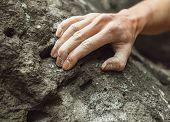 stock photo of climb up  - Woman climbing on rock outdoor close - JPG
